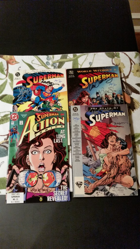 Superman books and trades I added signatures to.